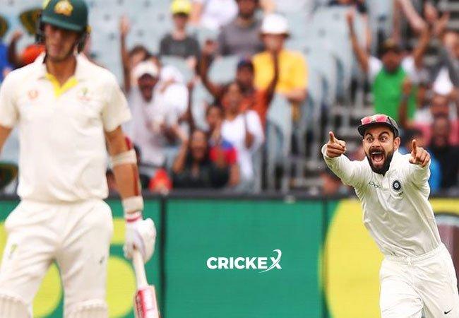 Virat Kohli is delighted as India dismisses Pat Cummins